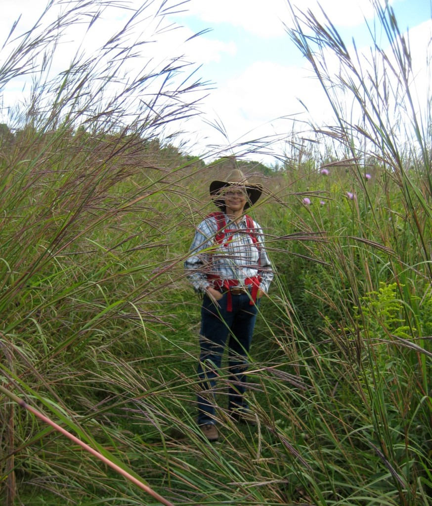 Jackie standing amidst big bluestem