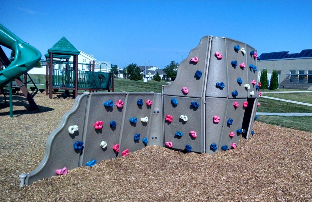 Playground climbing wall and Prairie Fields Park
