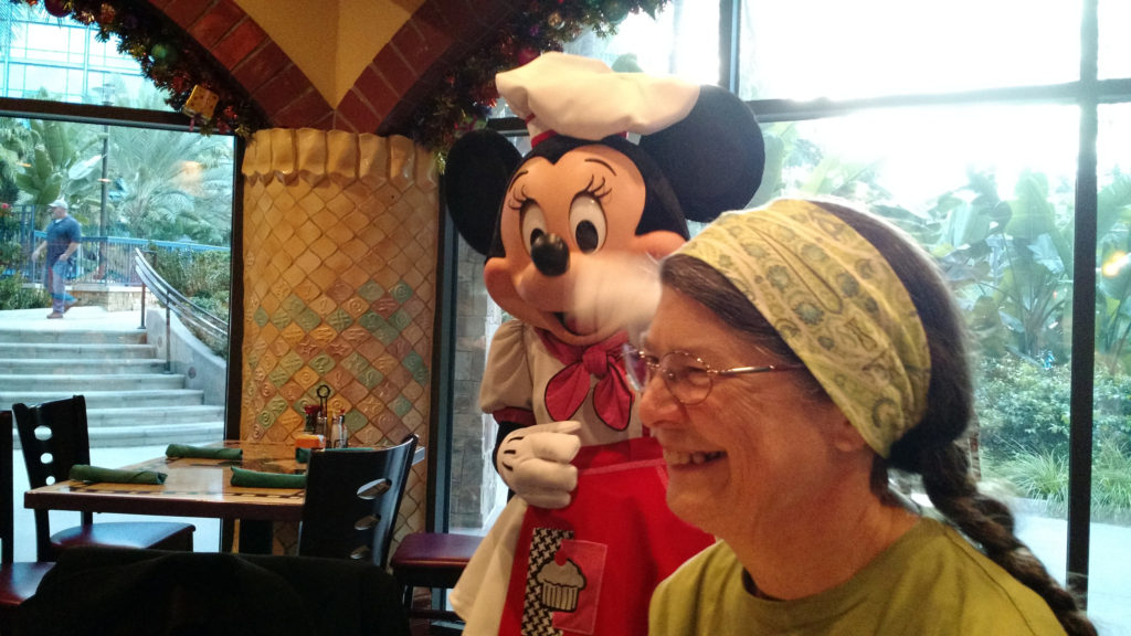 Jackie in Goofy's Kitchen, with Minnie.